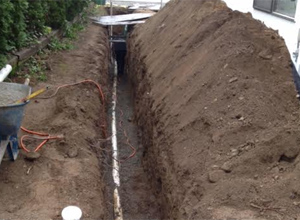 trench dug out for a Shoreline sewer replacement job